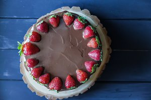 Delicious cake with fresh strawberry and dark chocolate decoration