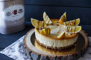 Delicious cake with orange wedges and chocolate sauce