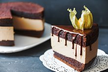 Delicious cake with chocolate sauce and slace of this cake