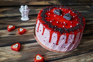 Delicious cake with chocolate chip and strawberry jam decoration