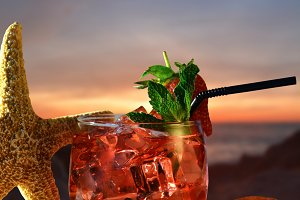 Mojito of Strawberry in a sunset