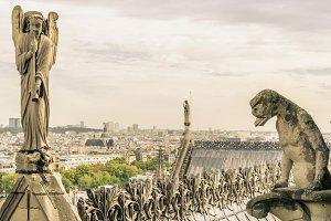Gargoyle and angel in Paris