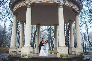 Newlyweds under the stone porch