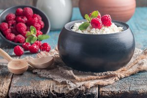 Fresh homemade cottage cheese with raspberries