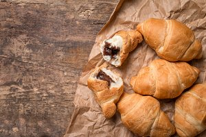 Fresh croissants over wooden background