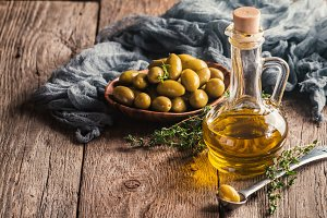 Olive oil and bowl of olives
