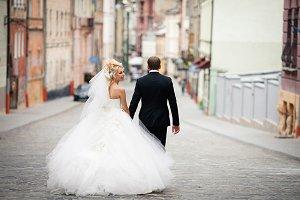 Funny bride looks over her shoulder