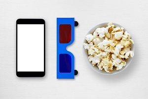 Smartphone, 3d glasses and popcorn