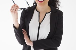 Businesswoman with glasses on neutral background