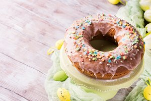 Easter cake with sugar frosting decorative eggs