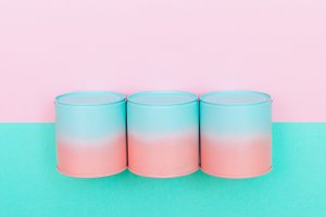 pink and blue cans of soup