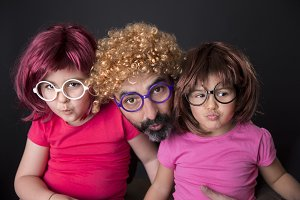 Father and children in wigs