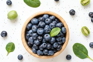 Fresh blueberries and greens