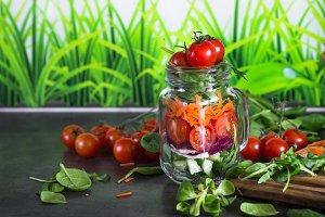 Fresh vegetarian salad in mason jar.