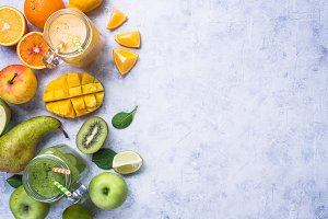 Green and yellow smoothie in mason jar