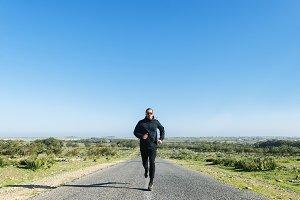 Runner man athlete running.