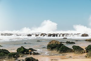 The waves breaking on a stony beach,