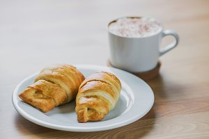 a Cup of coffee and two croissants