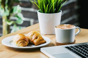 coffee, croissants and computer