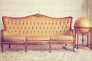 Vintage furniture sofa with globe
