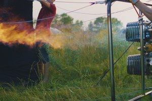 Power double burner burns hot air balloon, close up