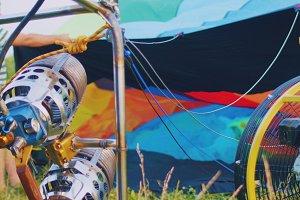 Gasoline burner burns hot air colorful balloon, close up