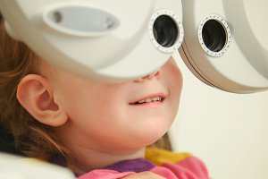 Healthcare - little cute adorable girl in ophthalmologist room