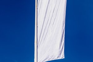 White flag over the sky
