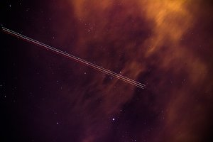 Plane In Night Sky