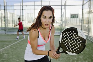 Sexy woman play paddle tennis
