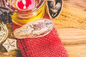 Potpourri and cinnamon sticks on burlap background