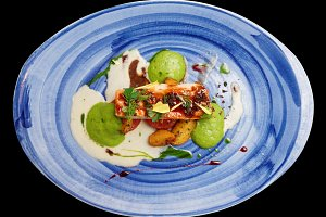 Chicken fillet on blue plate