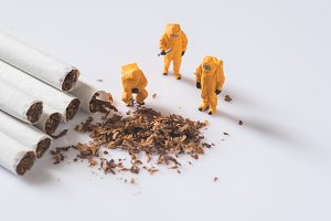 miniature people and cigarette