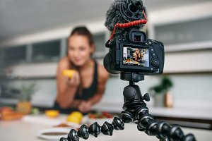 Young female blogger recording