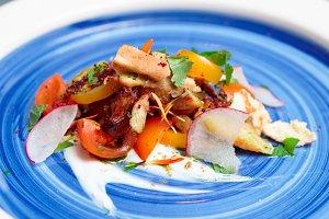 Chicken salad on blue plate