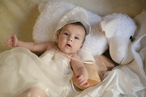 Baby with baptism clothes