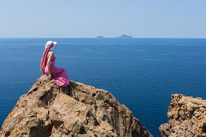 Woman in a long dress , Santorini