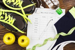 Green sneakers, headphones and sports bra