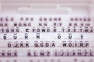 Burn out letters in focus between other blurred lettters