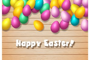 Easter frame with shiny colorful happy eggs spread over wooden b