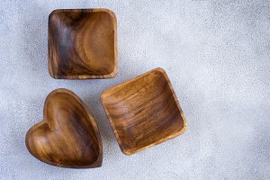 Wooden bowls on a concrete background