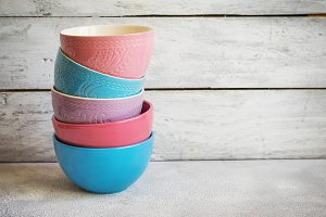 Colorful  pastel ceramic bowls  on white background, copy space