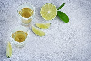 Mexican tequila gold in short glasses with salt and  lime slices