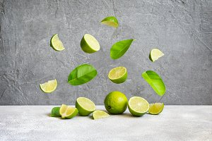 Limes and flying slices and leaves, copy space