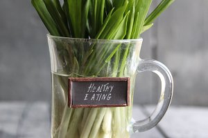 healthy eating tag and wood garlic on vintage table