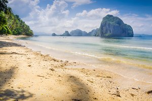Landscape of El Nido. Sandy Beach with Huge Rock, Palawan island. Philippines