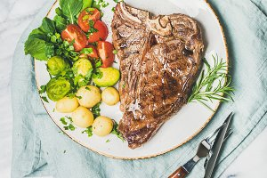 Grilled meat dinner plate