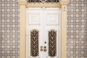 Old building tile facade and door