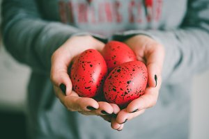 Easter eggs in hands