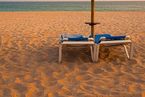 Empty deck loungers in the beach
